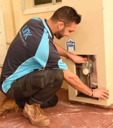 One of our Plumbers installing a Storage HWU